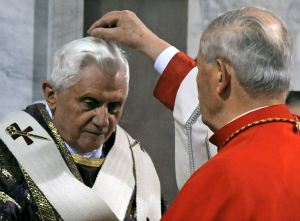 Cardinal Tomko signs Pope Benedict XVI's forehead with ash at Santa Sabina Basilica in Rome